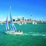 Sailing boat with Auckland cityscape